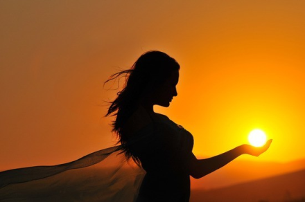 woman-sunset-sunrise-silhouette-holding-sunball