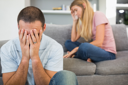 Couple having difficulties in sitting room at home